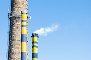 Industrial chimneys with smoke