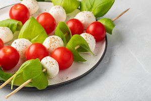 Caprese salad - skewer with tomato,