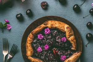 Cherry pie on wooden plate