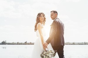 couple in wedding attire with a bouq