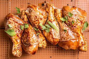 Raw marinated chicken drumsticks