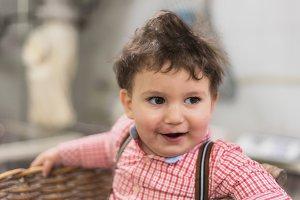 Portrait of a cute baby inside a bas