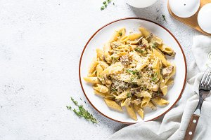 Pasta with white mushrooms in creamy