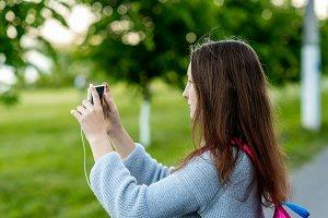 Girl schoolgirl in summer outdoors