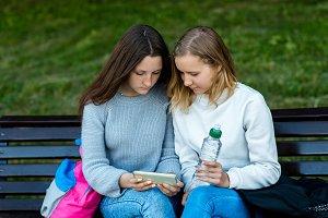 Two schoolgirls student. In summer