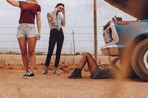 Women on roadtrip having a problem