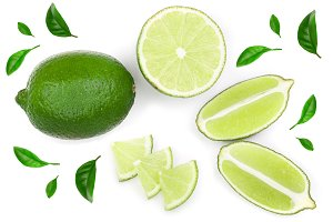 sliced lime with leaves isolated on