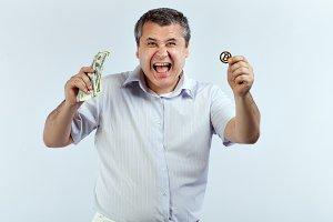 Joyous man with bitcoin.