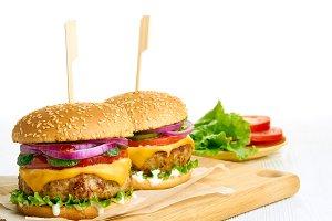 Two juicy cheeseburgers close-up