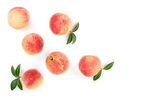 ripe peaches with leaves isolated on