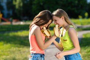 Girls are schoolgirls. Eat bananas