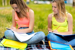 Two girls are female students. In