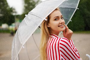 girl with transparent umbrella in
