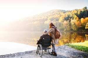 Senior couple with wheelchair in