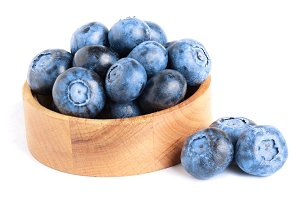 fresh ripe blueberry in wooden bowl