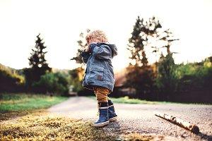 A little toddler boy standing