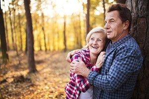 Senior couple on a walk in an autumn