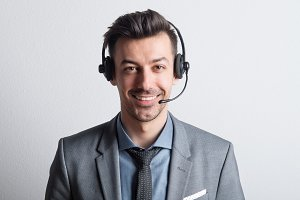 Portrait of a young man with headset