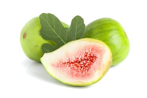 Ripe green fig fruit and half with