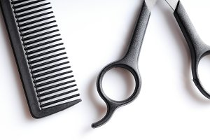 Barber scissors and comb closeup top