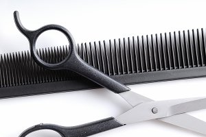 Scissors over comb closeup top