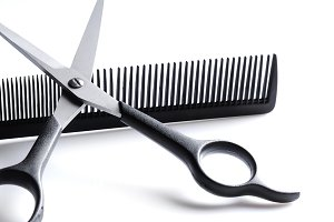 Scissors resting on barber comb