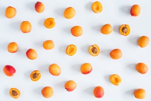 Apricots on blue background.