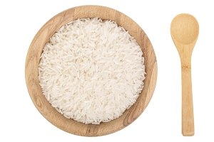 rice grains in wooden bowl isolated