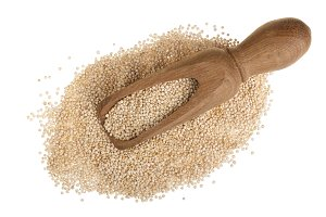 red quinoa seeds in wooden scoop