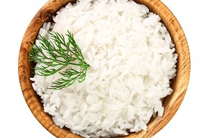 rice in a wooden bowl isolated on
