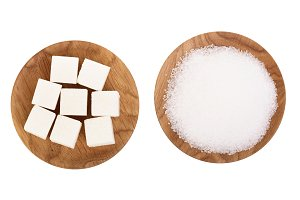 granulated sugar and cube in wooden
