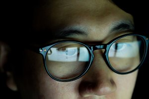 Close up of Young Asian man in glass