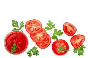 Tomato juice in glass and tomatoes