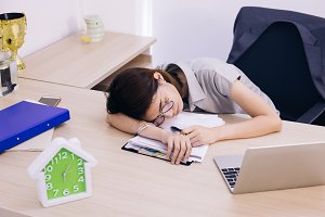 Young Asian sleeping office female e