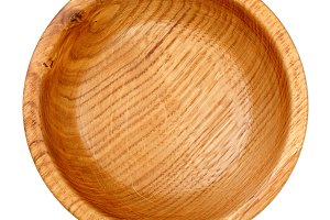 Empty wooden bowl isolated on white