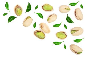 Pistachios with leaves isolated on