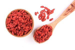 Dried goji berries in wooden bowl
