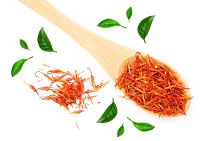 Heap of saffron in wooden spoon