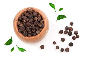 Black peppercorn in a wooden bowl