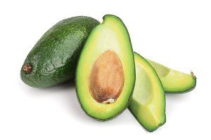 whole and half avocado isolated on