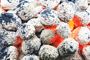 Burned BBQ coals in outdoor camping
