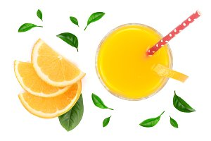 orange juice glass with slices of