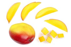 Mango fruit and slices isolated on