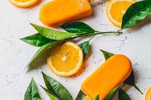 Homemade orange ice cream on stick