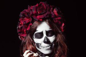 Woman with calavera (muertos) makeup