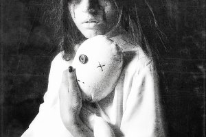Sad ghost girl with moppet doll