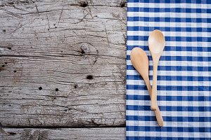 Tablecloth and spoon on wooden table