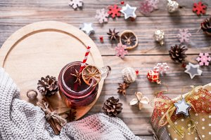 drink mulled wine on a wooden backgr