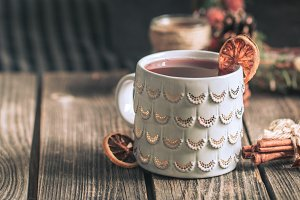 mulled wine in a cup on a wooden bac