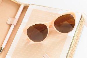 Stock Photo - Notebook & Sunglasses
